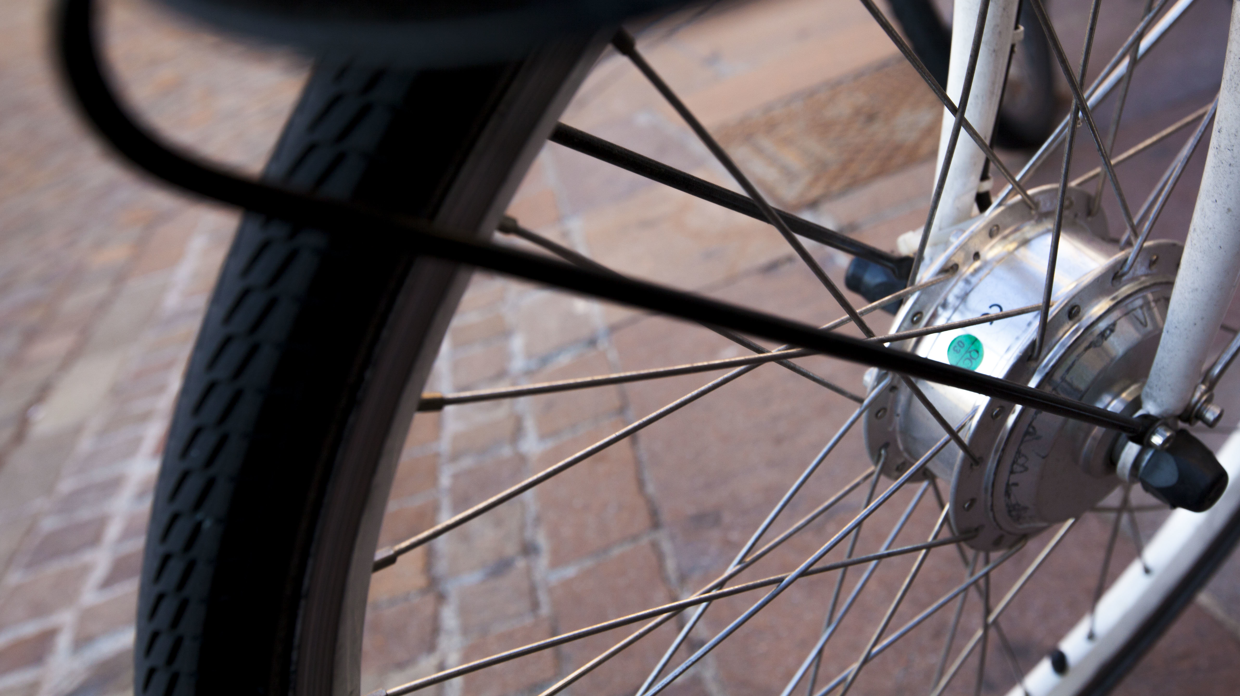 Close-up of a bicycle wheel.